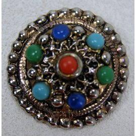 Broche ronde en métal cuivré